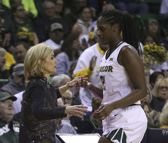 Baylor head coach Kim Mulkey thanks Baylor center Kalani Brown (21) as she head to the bench in the second half of an NCAA college basketball game, Saturday, March 2, 2019, in Waco, Texas. Baylor defeated Oklahoma State 76-44. (AP Photo/Jerry Larson)