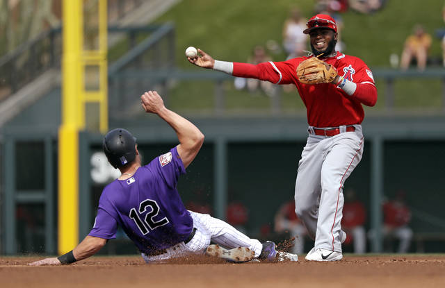 Los Angeles Angels second baseman Luis Rengifo, right, throws to first after forcing out Colorado Rockies' Mark Reynolds at second base in the second inning of a spring training baseball game Wednesday, March 6, 2019, in Scottsdale, Ariz. Rockies' Pat Valaika was safe at first on the fielder's choice play. (AP Photo/Elaine Thompson)