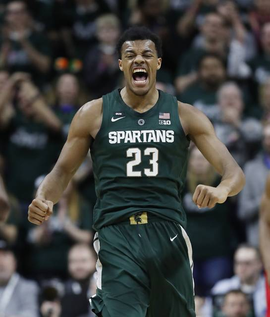 Michigan State forward Xavier Tillman reacts after a basket during the first half of an NCAA college basketball game against Nebraska, Tuesday, March 5, 2019, in East Lansing, Mich. (AP Photo/Carlos Osorio)