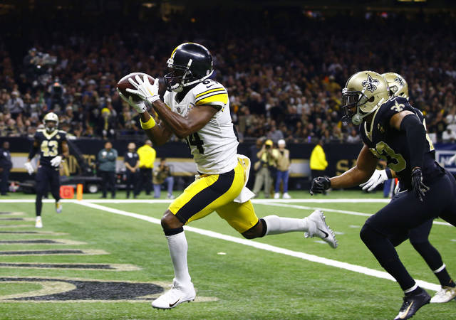 FILE - In this Dec. 23, 2018, file photo, Pittsburgh Steelers wide receiver Antonio Brown (84) pulls in a pass reception in front of New Orleans Saints cornerback Marshon Lattimore, foreground right, and strong safety Kurt Coleman in the second half of an NFL football game in New Orleans. A person with direct knowledge of the situation told The Associated Press on Saturday, March 9, 2019, that the Oakland Raiders have an agreement to acquire receiver Brown in a trade with the Steelers and will give him a new contract. (AP Photo/Butch Dill, File)