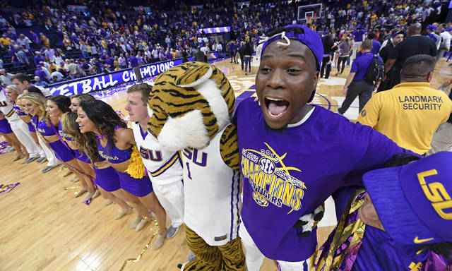 With his net strand tied to his hat, LSU forward Emmitt Williams (24) shouts with joy while celebrating with the Tiger Girls and Mike the Tiger mascot after an NCAA college basketball game, Saturday, March 9, 2019, in Baton Rouge, La. LSU won 80-59 thereby winning the SEC Conference outright. (AP Photo/Bill Feig)