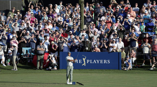 The gallery watches Tiger Woods tee off on the 17th hole during the first round of The Players Championship golf tournament Thursday, March 14, 2019, in Ponte Vedra Beach, Fla. (AP Photo/Lynne Sladky)