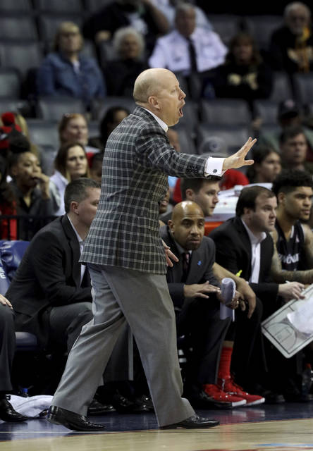 Cincinnati coach Mick Cronin shouts to his players during the first half of the team's NCAA college basketball game against Houston in the American Athletic Conference men's tournament final Sunday, March 17, 2019, in Memphis, Tenn. (AP Photo/Troy Glasgow)