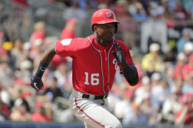 Washington Nationals' Victor Robles (16) runs to first base in the third inning of an exhibition spring training baseball game against the St. Louis Cardinals on Friday, March 8, 2019, in Jupiter, Fla. (AP Photo/Brynn Anderson)