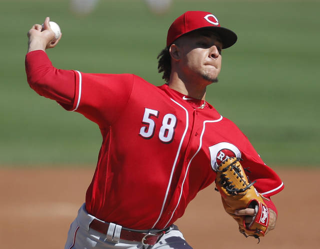FILE - In this Sept. 16, 2018, file photo, Cincinnati Reds' Luis Castillo pitches against the Chicago Cubs during the first inning of a baseball game in Chicago. Castillo has been picked to start on opening day for the Cincinnati Reds. Rookie manager David Bell made the announcement Tuesday, March 19, 2019, saying Castillo will get the ball March 28 at home against the Pittsburgh Pirates. (AP Photo/Jim Young, File)