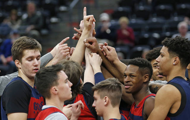Gonzaga players huddle following practice at the NCAA men's college basketball tournament Wednesday, March 20, 2019, in Salt Lake City. Gonzaga plays Fairleigh Dickinson on Thursday. (AP Photo/Rick Bowmer)