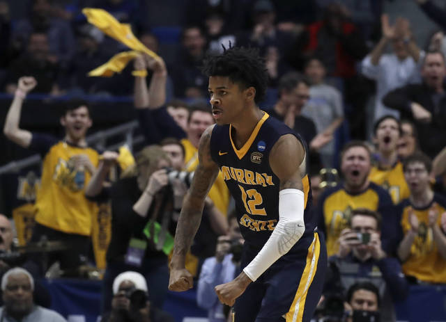 Fans cheer as Murray State's Ja Morant (12) celebrates a basket during the second half of a first round men's college basketball game against Marquette in the NCAA Tournament, Thursday, March 21, 2019, in Hartford, Conn. (AP Photo/Elise Amendola)