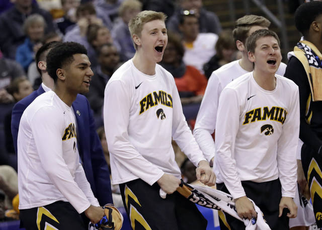 Iowa's bench celebrates late in the second half against Cincinnati during a first round men's college basketball game in the NCAA Tournament in Columbus, Ohio, Friday, March 22, 2019. Iowa won 79-72. (AP Photo/Tony Dejak)