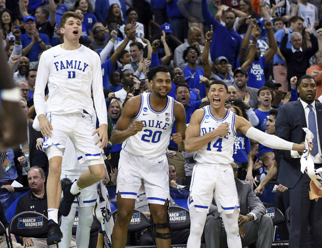 Duke's bench reacts to a play during the second half of the team's second-round men's college basketball game against Central Florida in the NCAA Tournament in Columbia, S.C. Sunday, March 24, 2019. (AP Photo/Richard Shiro)