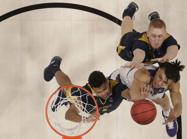 Kansas State guard Mike McGuirl, bottom right, shoots against UC Irvine guard Evan Leonard, left, and UC Irvine forward Collin Welp during the second half of a first round men's college basketball game in the NCAA Tournament Friday, March 22, 2019, in San Jose, Calif. (AP Photo/Ben Margot)