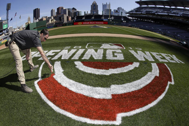 Andy Burnette, of the PNC Ground Crew paints, the Opening Week logo on the field at PNC Park Wednesday, March 27, 2019 in preparation for the Pittsburgh Pirates home-opener on Monday, April 1, against the St. Louis Cardinals. (AP Photo/Gene J. Puskar)