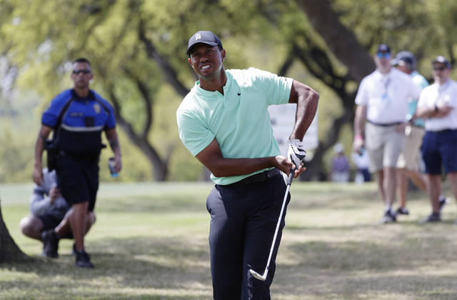 Tiger Woods watch his shot on the sixth hole during round-robin play at the Dell Technologies Match Play Championship golf tournament, Thursday, March 28, 2019, in Austin, Texas. (AP Photo/Eric Gay)