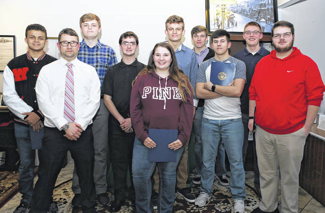 From left are Timothy Canon Ford, Instructor Christopher Pope, Brendan Powell, Jack Romer, Madison Stoops, Zane Carey, Graham Vilvens, Ryan Camp, Jonathan Fender and Zackary Evans.