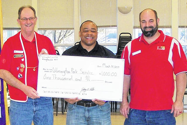 At the Monday night Lions Club meeting, Club President John Hibbs, left, presented Wilmington Parks & Rec Superintendent Jermaine Isaac, middle, with a $1,000 check for the Castle Park II Project. Lion Tony Winner, right, made the donation request at the Lions Club Board of Directors meeting. In addition to the Lions Club financial support, some club members expressed their desire to provide physical help during construction during build week in May.