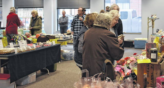 Despite the cold, locals still showed up at the Clinton County Spring Farmers Market on Saturday in the warmth of the Wilmington Municipal Building.