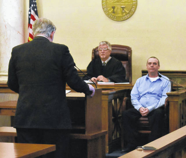 "Lee DeBord, sitting, answers questions from his attorney, Rob Baker, far left, during his testimony in Clinton County Common Pleas Judge John ""Tim"" Rudduck's courtroom on Wednesday."