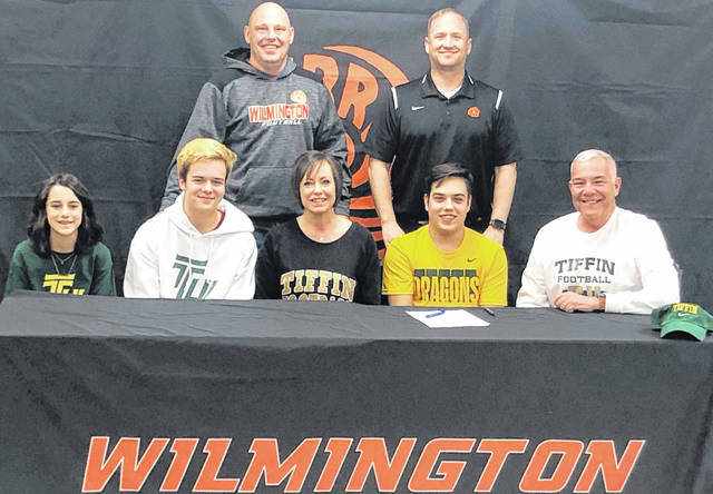 "Wilmington High School senior Brady Henry has chosen to continue his academic and athletic career at Tiffin University. Henry is a kicker on the WHS football team. ""Brady has chosen a great school where he can excel both academically and athletically,"" WHS head coach Scott Killen said. ""Tiffin got a great football player and an even better person."" In the photo, from left to right, front row, Reagan Henry, Parker Henry, Maggie Henry, Brady Henry, Dave Henry; back row, assistant football coach J.D. McIntosh and head coach Scott Killen."