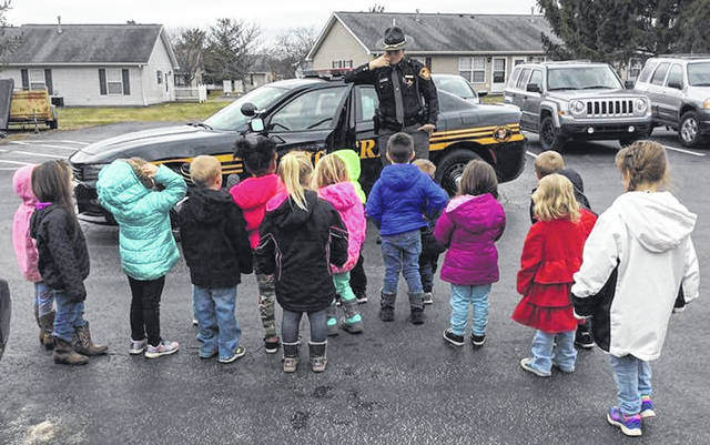 Head Start appreciates the community and family members that participate in its program. Recently, Mrs. Bartlett and Ms. Eramo celebrated a classroom transportation project by inviting Clinton County Sheriff's Deputy Karen Abbitt to talk to the students about safety. The children enjoyed hearing the siren and observing the patrol car. In addition, Head Start staff members hosted a Math Night for its preschool families. They thank Wilmington City Schools for joining them and providing the families with the opportunity to register their children for kindergarten.