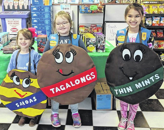 Selling Girl Scout cookies at J&D's Market in Sligo over the weekend are super salesgirls Ryleigh, Adalee and Lilliannah.