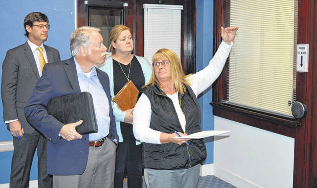The current configurations of the former Board of Elections Office at the courthouse are examined Wednesday for an upcoming relocation to the space by the Adult Probation Department. From left in the foreground are Casler Design Group President Bill Casler and Clinton County Commissioners President Brenda Woods, and from left in the background are Commissioner Kerry Steed and County Administrator Mary Ann Haines Foland.