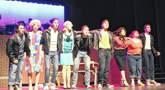 "Theatre at Wilmington High School is going back to the '50s to present the musical ""Grease"", set for Thursday, Friday and Saturday — March 14-16 at 7:30 p.m. — and Sunday, March 17 at 2 p.m. at the WHS Auditeria. There are no reserve tickets available; tickets are sold as stand-by only. Any available seats or unclaimed tickets may be purchased at the box the day of each performance. From left at Wednesday evening's dress rehearsal are Mason Snyder (as Doody), Autumn Housh (Frenchy), Simon Heys (Kenickie), Aubree Trusty (Marty), Aidan Greene (Sonny), Zach Davis (Danny), Sydney Johnston (Rizzo), Alana Walker (Jan) and Kade Neu (Roger)."