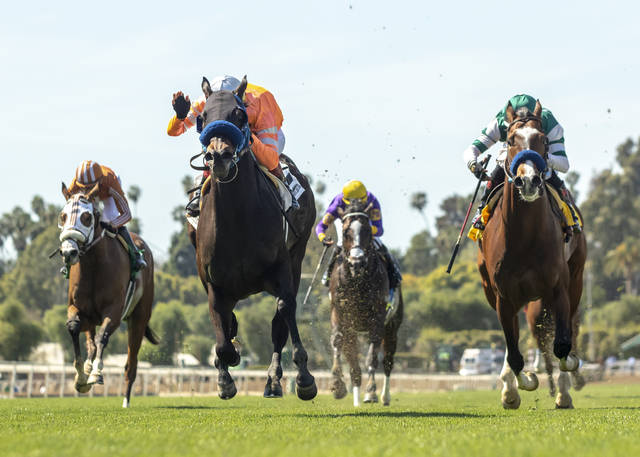 This image provided by Benoit Photo shows Law Abidin Citizen and jockey Tiago Pereira, second from left, outlegging Mesut (Geovanni Franco), left, Air Vice Marshal (Martin Garcia), third from left, and Cistron (Rafael Bejarano), right, to win the Grade III, $100,000 San Simeon Stakes, Sunday, March 31, 2019 at Santa Anita Park, Arcadia Calif. (Benoit Photo via AP)