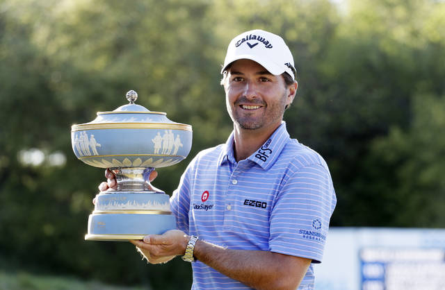 Kevin Kisner poses with his trophy after he defeated Matt Kuchar in the finals at the Dell Technologies Match Play Championship golf tournament, Sunday, March 31, 2019, in Austin, Texas. (AP Photo/Eric Gay)