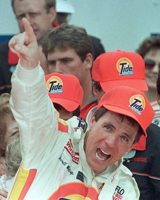 FILE - In this Feb. 19, 1989, file photo, Darrell Waltrip celebrates in Victory Lane after winning the Daytona 500 auto race in Daytona Beach, Fla.  Waltrip will soon Boogity! Boogity! Boogity! his way into retirement. Everyone yearns for an opportunity to say farewell on their own terms, so with that, Waltrip should bring his second career as a NASCAR broadcaster to a close and squeeze out his classic catchphrase on his own terms as Fox Sports closes its portion of the broadcast deal. (AP Photo/Doug Jennings, File)