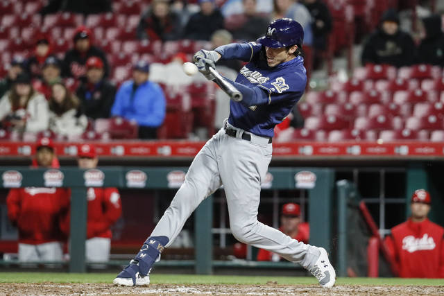 Milwaukee Brewers' Christian Yelich hits a double off Cincinnati Reds relief pitcher Raisel Iglesias in the ninth inning of a baseball game, Monday, April 1, 2019, in Cincinnati. (AP Photo/John Minchillo)