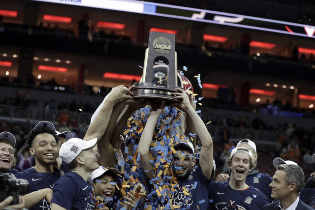 FILE - In this March 30, 2019, file photo, members of Virginia celebrate after defeating Purdue 80-75 in overtime of the men's NCAA Tournament college basketball South Regional final game in Louisville, Ky. An Associated Press analysis of rosters of perennial NCAA Tournament teams concludes it takes NBA-caliber talent to go far consistently. And though this year's Final Four is being touted as one in which experience and teamwork won out over raw talent, three of the teams in Minneapolis, including Virginia, possess that young NBA talent. (AP Photo/Michael Conroy, File)