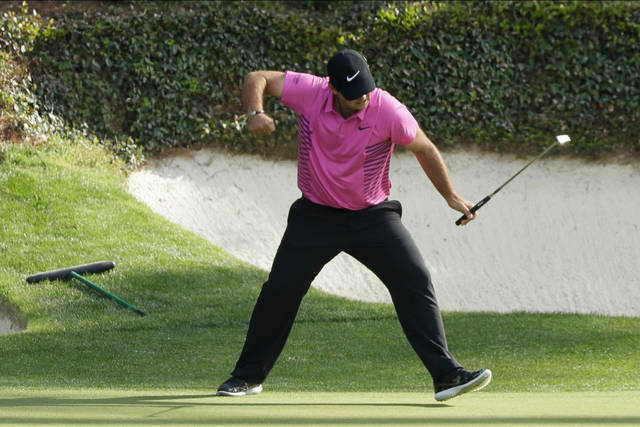 FILE - In this April 8, 2018, file photo, Patrick Reed reacts to his birdie on the 12th hole during the fourth round at the Masters golf tournament in Augusta, Ga. Reed will try to become the first back-to-back Masters champion since Tiger Woods in 2002. (AP Photo/David J. Phillip, File)