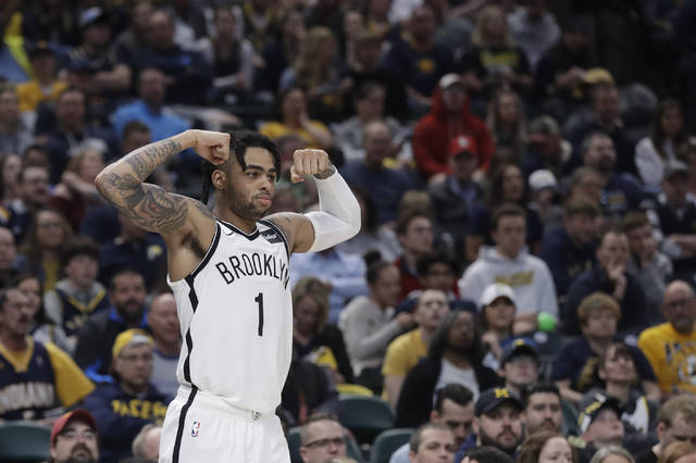 Brooklyn Nets' D'Angelo Russell reacts after a Brooklyn basket during the second half of the team's NBA basketball game against the Indiana Pacers, Sunday, April 7, 2019, in Indianapolis. Brooklyn won 108-96. (AP Photo/Darron Cummings)