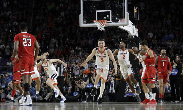 Virginia's Kyle Guy (5) and his teammates celebrate after defeating Texas Tech 85-77 in the overtime in the championship of the Final Four NCAA college basketball tournament, Monday, April 8, 2019, in Minneapolis. (AP Photo/David J. Phillip)