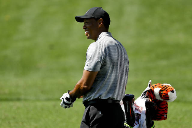 Tiger Woods smiles on the driving range at the Masters golf tournament Tuesday, April 9, 2019, in Augusta, Ga. (AP Photo/Matt Slocum)