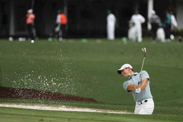 Rory McIlroy, of Northern Ireland, practices on the driving range at the Masters golf tournament Tuesday, April 9, 2019, in Augusta, Ga. (AP Photo/Matt Slocum)
