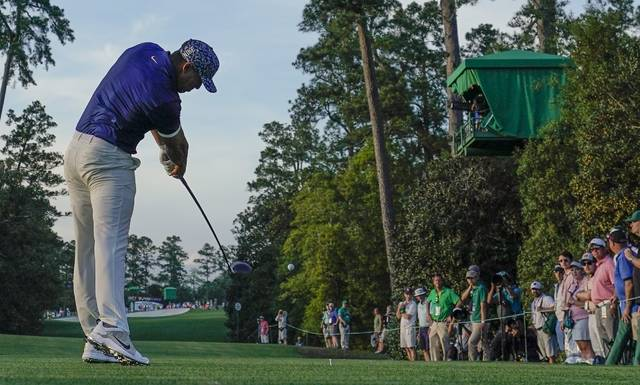 Brooks Koepka hits on the 18th tee during the first round for the Masters golf tournament Thursday, April 11, 2019, in Augusta, Ga. (AP Photo/David J. Phillip)