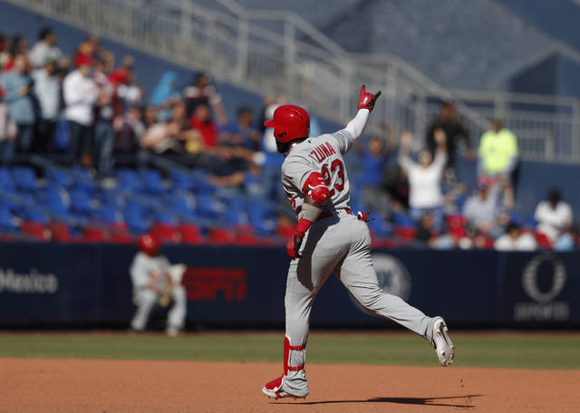 St. Louis Cardinals' Marcell Ozuna gestures to fans as he runs the bases after hitting his second home run of the game, during the seventh inning of a baseball game against the Cincinnati Reds in Monterrey, Mexico, Sunday, April 14, 2019. (AP Photo/Rebecca Blackwell)