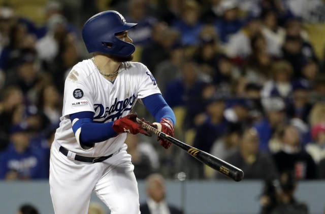 Los Angeles Dodgers' Alex Verdugo watches his two-run double during the seventh inning of the team's baseball game against the Cincinnati Reds on Tuesday, April 16, 2019, in Los Angeles. (AP Photo/Marcio Jose Sanchez)