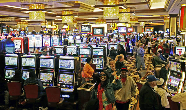 FILE - In this March 4, 2013 file photo, patrons fill the gaming floor at Horseshoe Casino Cincinnati after it opened to the public in Cincinnati.  Ohio's lawmakers will spend the coming months in 2019 debating the future and shape of sports betting in the state.  Two competing proposals have been proposed in the state legislature within recent weeks that would legalize wagering on sports.  (AP Photo/Al Behrman, File)