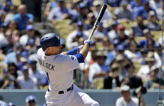 Los Angeles Dodgers' A.J. Pollock hits a three-run home run off Cincinnati Reds starting pitcher Sonny Gray during the sixth inning of a baseball game Wednesday, April 17, 2019, in Los Angeles. (AP Photo/Marcio Jose Sanchez)