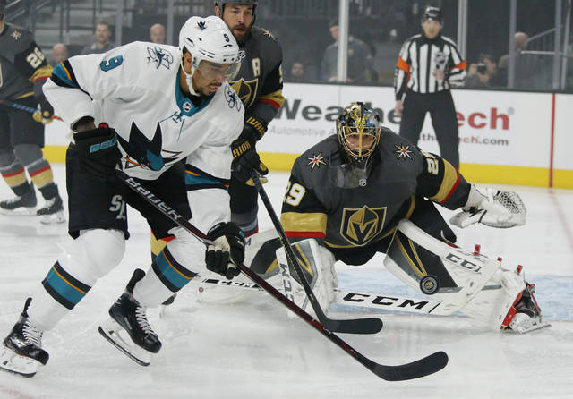 Vegas Golden Knights goaltender Marc-Andre Fleury (29) blocks a shot beside San Jose Sharks left wing Evander Kane during the first period of Game 4 of a first-round NHL hockey playoff series Tuesday, April 16, 2019, in Las Vegas. (AP Photo/John Locher)