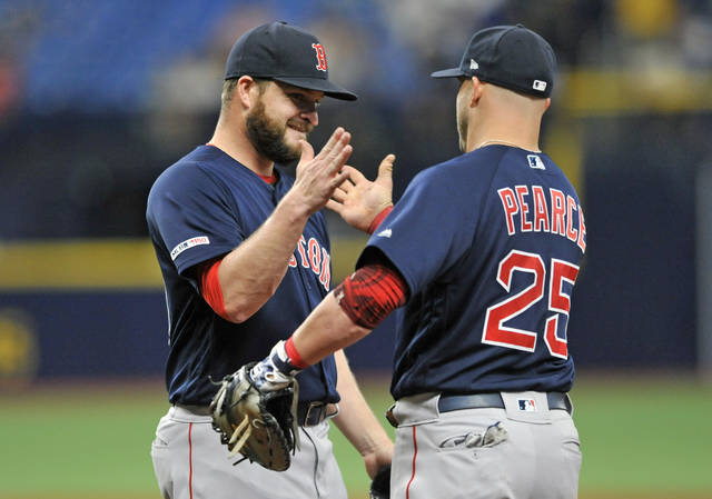 Boston Red Sox closer Ryan Brasier, left, celebrates with first baseman Steve Pearce (25) after the Red Sox beat the Tampa Bay Rays 4-3 during an 11-inning baseball game Sunday, April 21, 2019, in St. Petersburg, Fla. (AP Photo/Steve Nesius)
