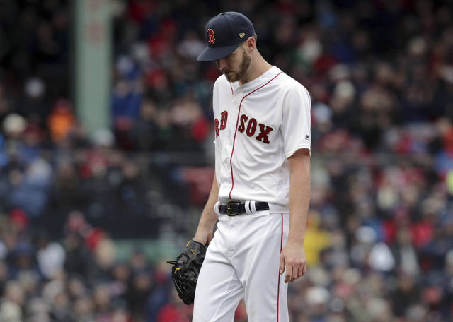 Boston Red Sox starting pitcher Chris Sale walks off the mound after the top of the fourth inning of the home opener baseball game against the Toronto Blue Jays, Tuesday, April 9, 2019, in Boston. (AP Photo/Charles Krupa)