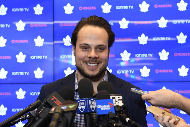 "FILE - In this Tuesday, Feb. 5, 2019 file photo, Toronto Maple Leafs center Auston Matthews smiles at a press conference in Toronto. Auston Matthews could soon wear the ""C"" as the long-term captain in Toronto. But he also got razzed by his Maple Leafs teammates for doing a stylish GQ fashion photo shoot.  (Nathan Denette/The Canadian Press via AP, File)"