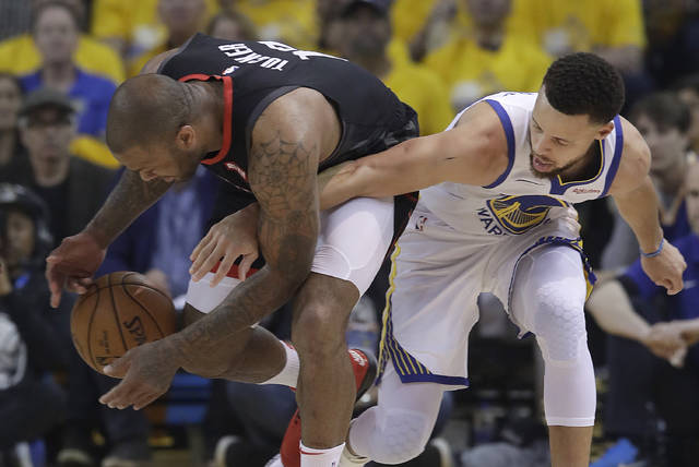 Houston Rockets forward PJ Tucker, left, grabs the ball next to Golden State Warriors guard Stephen Curry during the first half of Game 1 of a second-round NBA basketball playoff series in Oakland, Calif., Sunday, April 28, 2019. (AP Photo/Jeff Chiu)