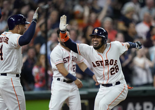 Houston Astros' Robinson Chirinos (28) celebrates with George Springer (4) after hitting a three-run home run against the Cleveland Indians during the seventh inning of a baseball game Sunday, April 28, 2019, in Houston. (AP Photo/David J. Phillip)