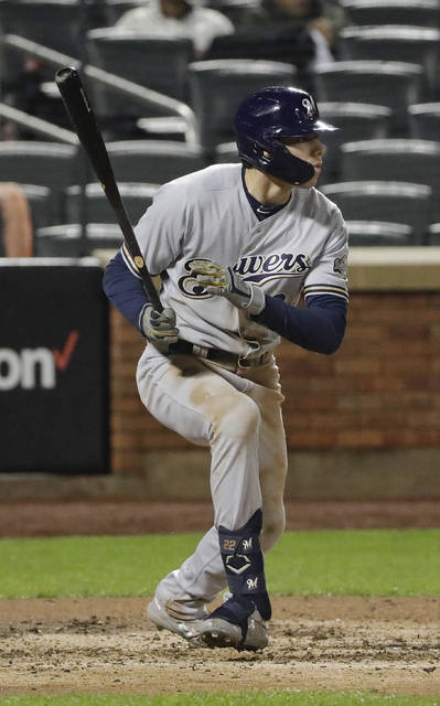 Milwaukee Brewers' Christian Yelich hits an RBI single during the fifth inning of a baseball game against the New York Mets Friday, April 26, 2019, in New York. (AP Photo/Frank Franklin II)