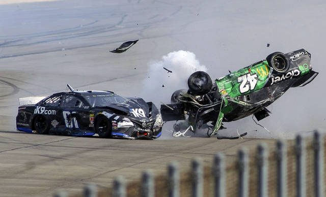 Kyle Larson (42) flips as he makes contact with  Jeffrey Earnhardt (81) on the back stretch during a NASCAR Cup Series auto race at Talladega Superspeedway, Sunday, April 28, 2019, in Talladega, Ala. (AP Photo/Greg McWilliams)