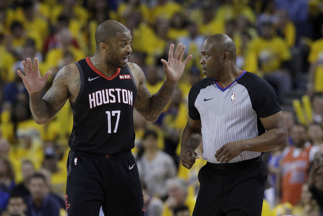 Houston Rockets forward PJ Tucker (17) gestures while talking to referee Courtney Kirkland during the second half of Game 1 of a second-round NBA basketball playoff series between the Golden State Warriors and the Rockets in Oakland, Calif., Sunday, April 28, 2019. (AP Photo/Jeff Chiu)