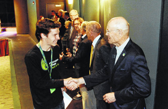 Simon Heys, an incoming freshman from Wilmington planning to major in sport management, accepted words of congratulations from Trustee Rich Sidwell as he reaches the end of the line of well-wishers that included faculty, staff and trustees. Simon also plans to run track and cross country for the Fighting' Quakers.